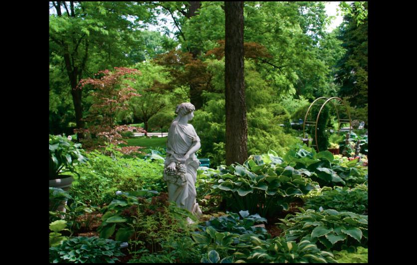 garden statuary with hostas