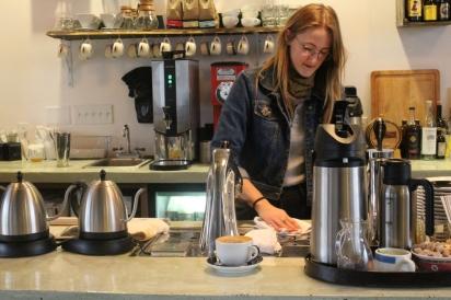 Someone making a coffee