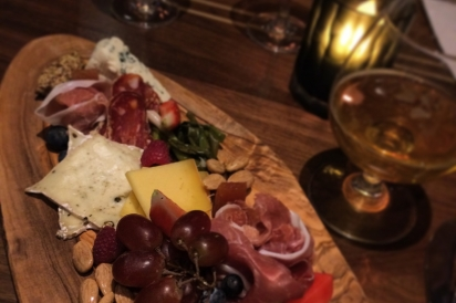 A board of local cheeses, meats, pickled vegetables and more