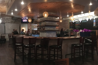 The bar in the center of everything at Louie's Wine Dive & Ripple Kitchen.