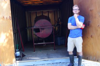 Caleb Michalke shows off Sugar Creek Malt Co.'s smokehouse and smoker.