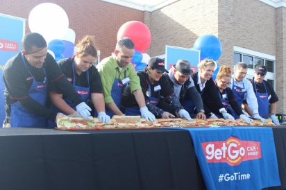 """Michael Symon at the Plainfield GetGo grand opening """"ribbon"""" cutting ceremony."""
