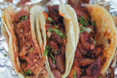 A three-taco combination of pork, chicken and steak from West Coast Tacos