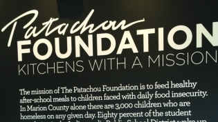 The sign as you walk into Public Greens explaining the mission of The Patachou Foundation.